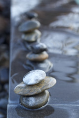 Spa stones beside the pool.