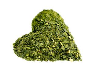 Healthy heart shaped dried green tea