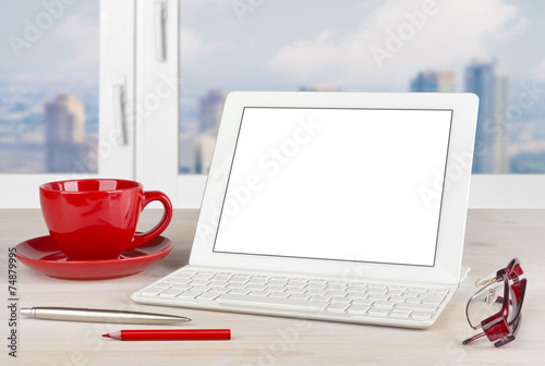 Tablet PC with keyboard and red mug on office table - 74879995