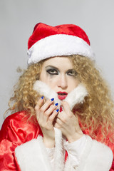 Close-up portrait of a crying woman Santa with flowing mascara