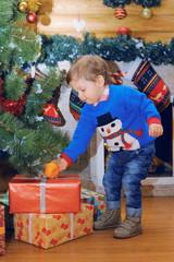 A Little Boy in Christmas Entourage