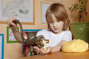 Boy Grinding Flour