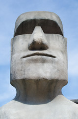 Stone sculpture of a Moai statue.