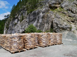 Wood for the fire place in bags along a road