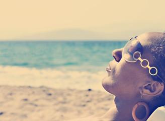 Young black woman sunbathing