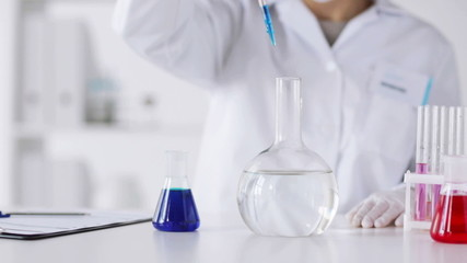 close up of scientist making research in lab