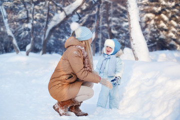 Mother with his Child playing in Winter