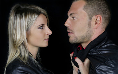 young couple dressed in a black leather jacket