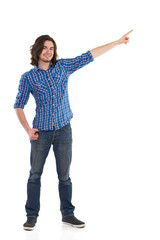 Young man in lumberjack shirt pointing