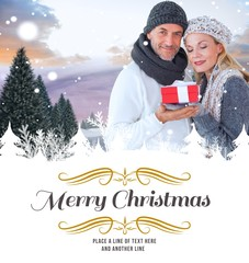 Composite image of happy winter couple with gift