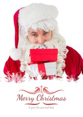 Composite image of smiling santa holding pile of gifts