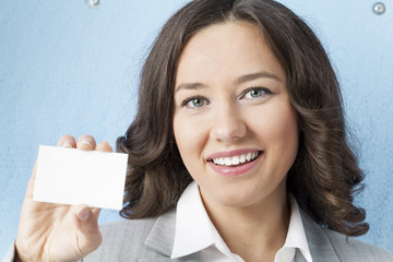 Businesswoman giving blank business card