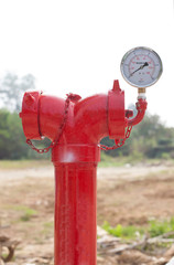 red metallic fire hydrant with pressure gauge or Fire Department
