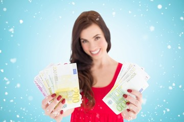 Composite image of cheerful brunette showing her cash money