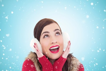 Composite image of surprised brunette in winter clothes