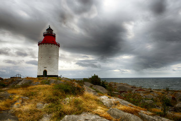 Red lighthouse on the small island in front of Smughen