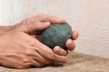 Raw clay in the hands of women