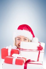 Festive blonde holding pile of gifts