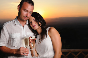 Romantic couple toasting at sunset