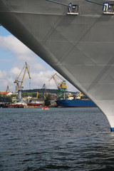 shipyard with cranes and ships