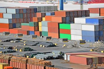 Cargo container, lumber, pipe and train in port Odessa, Ukraine