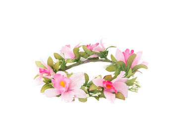 Tiara of artificial flowers on White Isolate background.