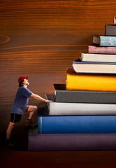 climber climbs a heap of books
