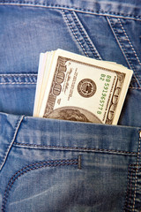 Jeans with american dollar bills in its pocket