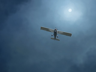 airplane in a stormy sky