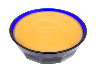 Butterscotch pudding in a blue bowl