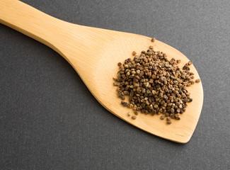 Cardamom seeds on wood spoon