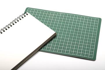 notebook and cutting mat