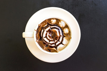 art caramel coffee in white cup