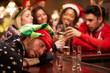 Man Passed Out On Bar During Christmas Drinks With Friends - 74891370
