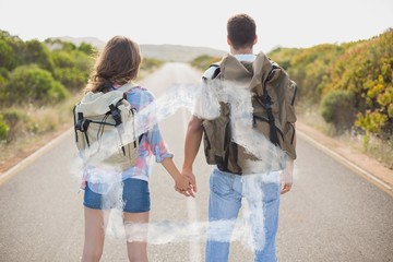 Composite image of hiking couple standing on countryside road