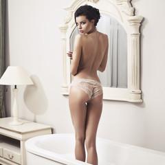 Beautiful nude sexy woman in the bath