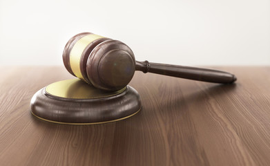 Wooden gavel on the table on blurred background