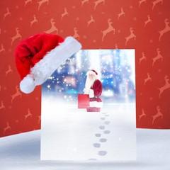 Composite image of santa hat on poster