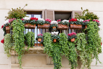 traditional balcony with flowers, old style, Italy