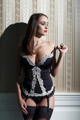 Sexy woman undress corset
