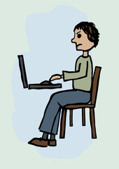 A man working at a computer