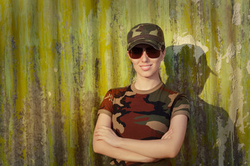 Smiling Young Woman in Soldier Camouflage Outfit