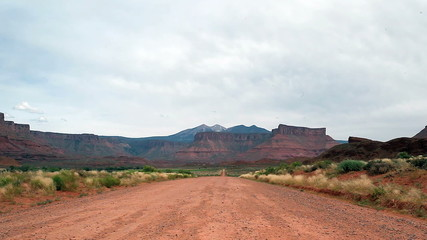 Dirt road in barren landscape of Utah, USA