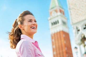Portrait of happy young woman against campanile di san marco