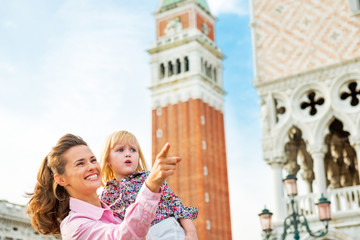 Portrait of mother and baby against campanile di san marco