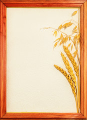 Postcard of yellow wheat ears on a light piece of paper