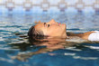 Leinwanddruck Bild - Profile of a beauty relaxed woman face floating in water