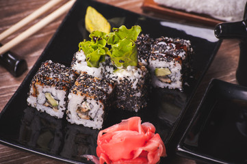 eel sushi roll with sesame seeds