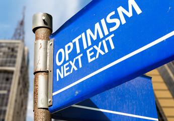 Optimism Next Exit blue road sign