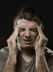 man suffering migraine headache and desperate pain in stress